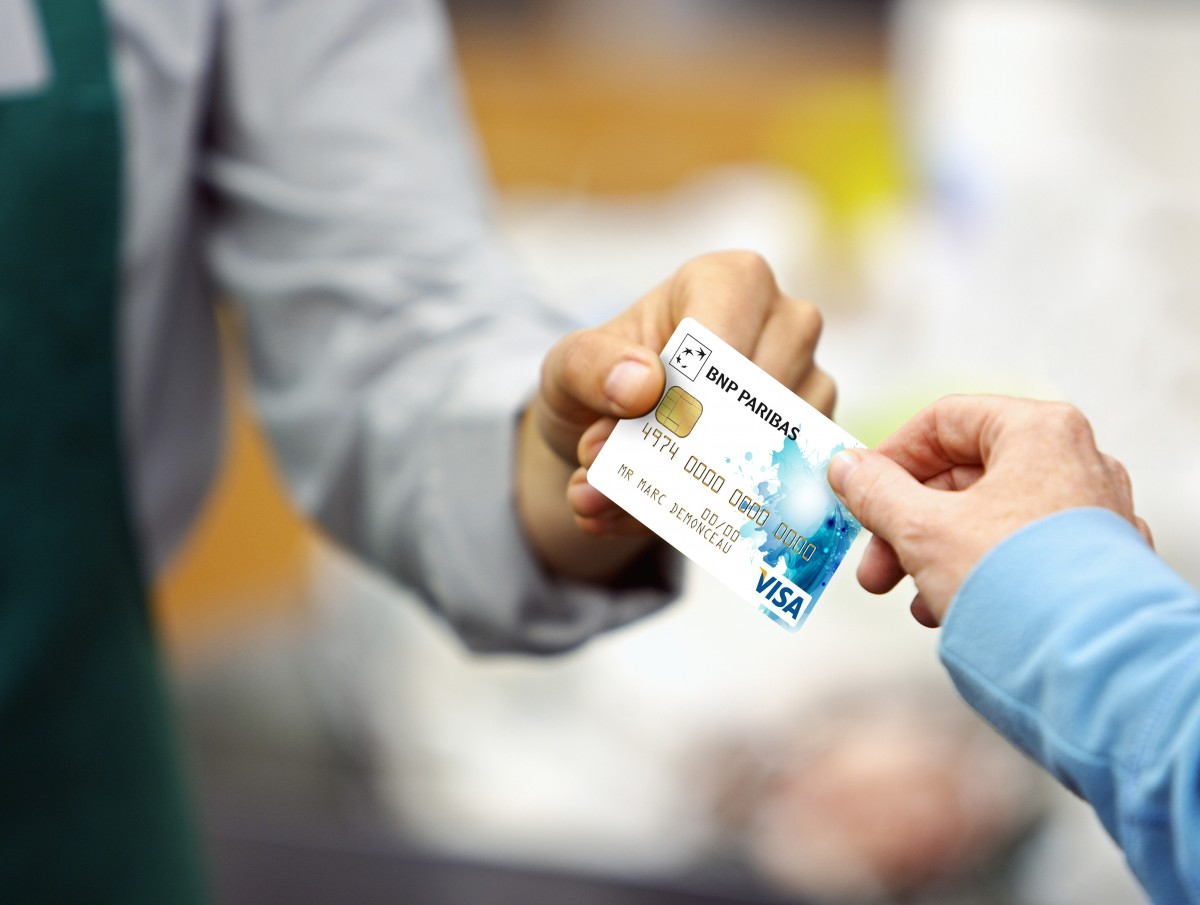 Customer Giving Clerk Credit Card
